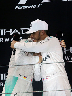 The podium: second place Nico Rosberg, Mercedes AMG F1 celebrates his World Championship with race winner and team mate Lewis Hamilton, Mercedes AMG F1