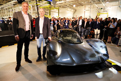 Marek Reichman- Executive Vice President & Chief Creative Officer, Aston Martin Lagonda Ltd and Adrian Newey, the Chief Technical Officer of Red Bull Racing stand next to the AM-RB 001 at the Aston Martin and Red Bull Racing Project AMRB 001 Unveil