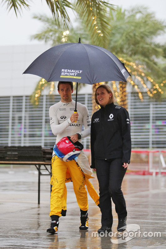 Jolyon Palmer, Renault Sport F1 Team in a wet and rainy paddock with Aurelie Donzelot, Renault Sport F1 Team Media Communications Manager