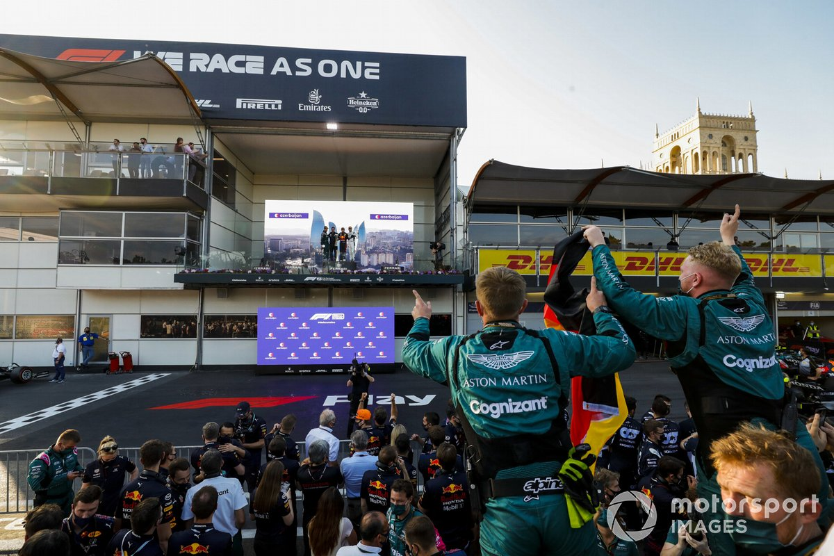 Sebastian Vettel, Aston Martin, 2nd position, the Red Bull Racing trophy delegate, Sergio Perez, Red Bull Racing, 1st position, and Pierre Gasly, AlphaTauri, 3rd position, on the podium