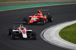 Charles Leclerc, ART Grand Prix leads Jack Aitken, Arden International