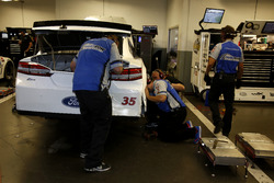 Mechanics working on the of David Gilliland, Front Row Motorsports Ford
