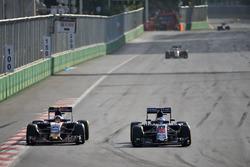 (L to R): Carlos Sainz Jr., Scuderia Toro Rosso STR11 and Fernando Alonso, McLaren MP4-31 battle for position