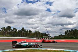 Nico Rosberg, Mercedes AMG F1 W07 Hybrid passes Sebastian Vettel, Ferrari SF16-H