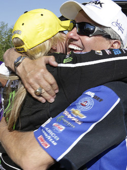 Top Fuel winner Brittany Force gets a hug from her father John Force