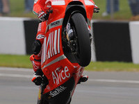 Resurgent Stoner takes British GP in style