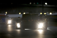 Porsche in early control at Daytona as the sun sets