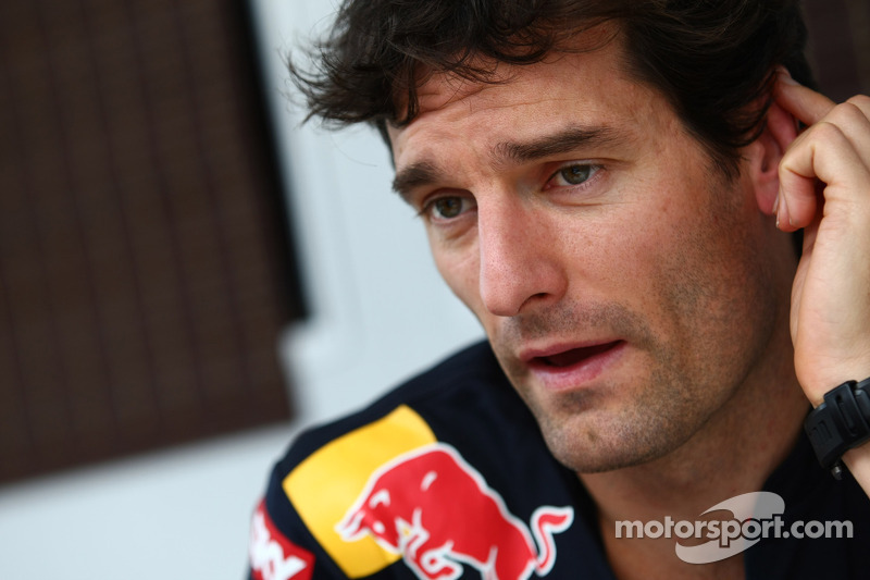 Webber enjoys wheelie on Grand Prix motorbike