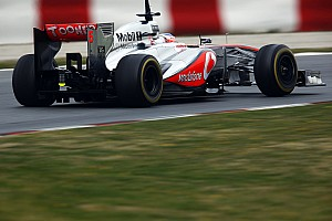 Button's first day testing in Barcelona focused on long runs and pitstops