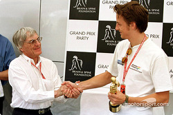 Grand Prix Party for the Brain & Spine Foundation: Jenson Button receiving his 'Bernie' award from Bernie Ecclestone