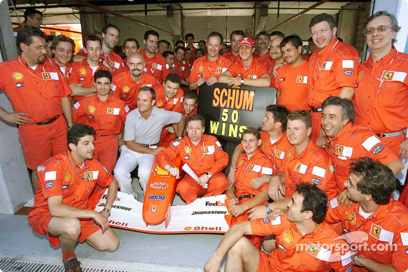 Michael Schumacher celebrating his 50th Grand Prix win with Team Ferrari
