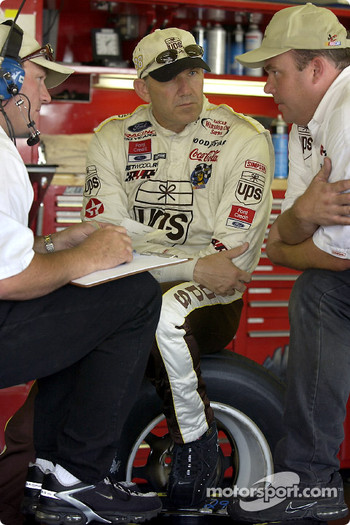 Dale Jarrett, tied for the lead in Winston Cup points goes over setup notes with crew