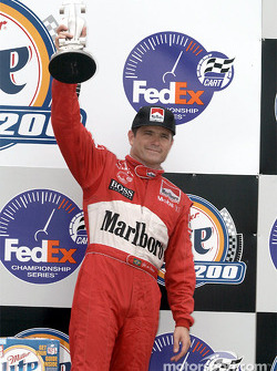 The podium: Gil de Ferran