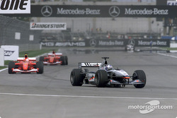 David Coulthard in front of Michael Schumacher