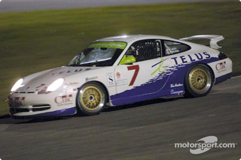 The #7 Doncaster Racing Porsche speeds into the darkness at the Grand-Am Finale