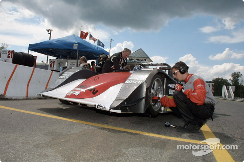 The Archangel Motorsports crew services the car between sprint races