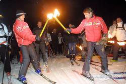 Michael Schumacher and Luca Badoer in the torch-light sky run