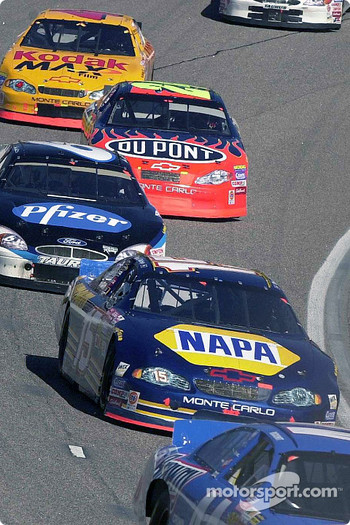 Michael Waltrip rounds turn four at Rockingham with Mark Martin and Jeff Gordon in toe