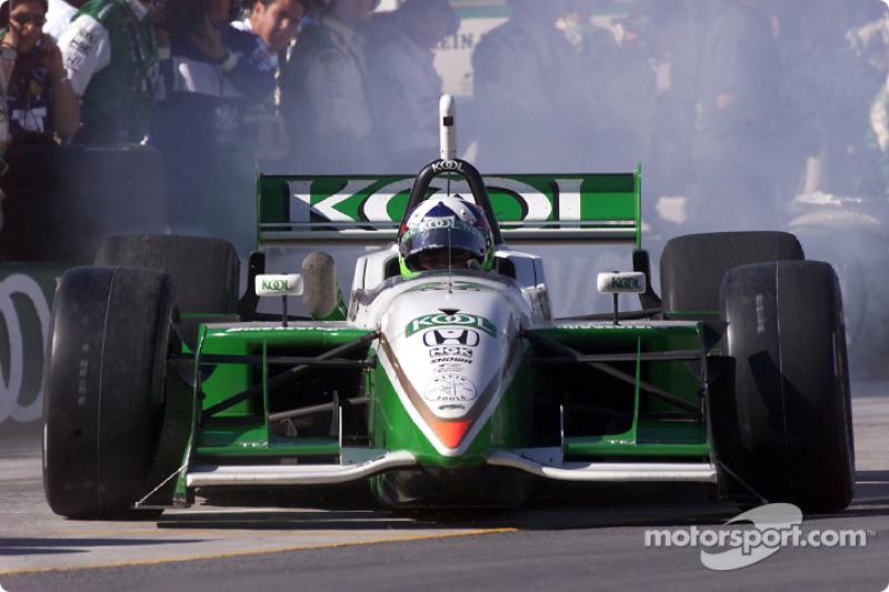 Dario Franchitti leaving pits