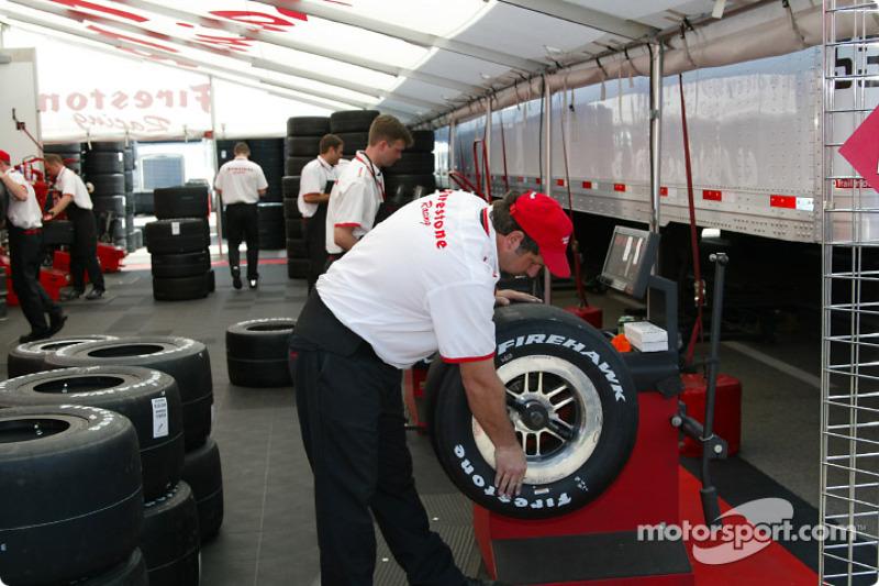 Firestone crew members preparing the tires