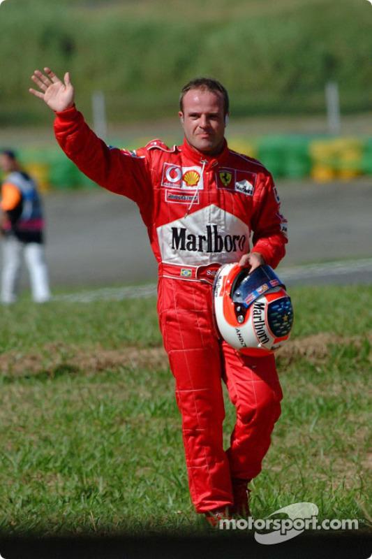 Rubens Barrichello walking back to the pits