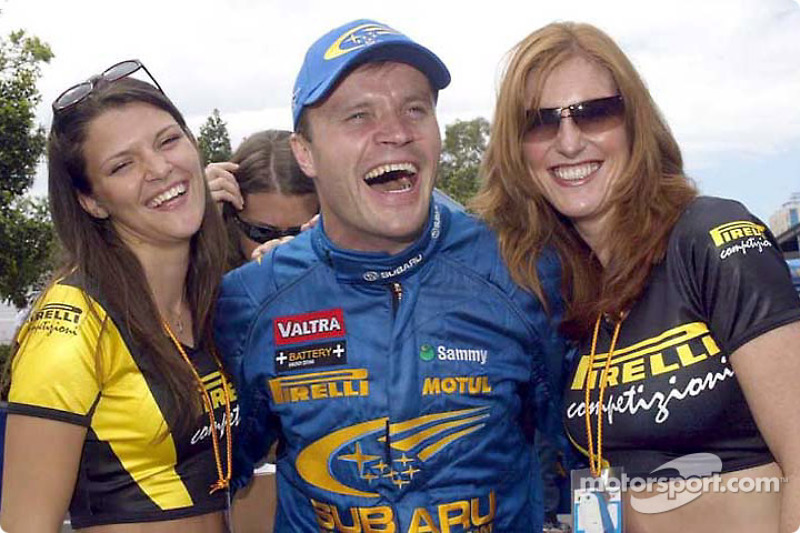 Tommi Makinen and the lovely Pirelli girls