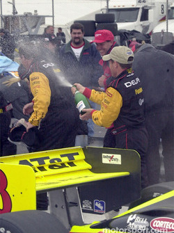 Champagne in the midst of a rainy Victory Lane ceremony