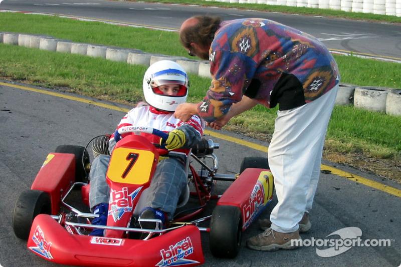 Donatella Di Giorgio discussing with journalist and racing driver Maurizio Voltini