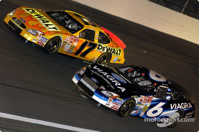 Mark Martin and Matt Kenseth battle for the lead early in The Winston