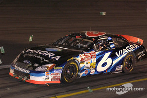 Mark Martin takes a victory lap amidst the dollar bills after winning the No Bull 5 million dollar bonus at Charlotte