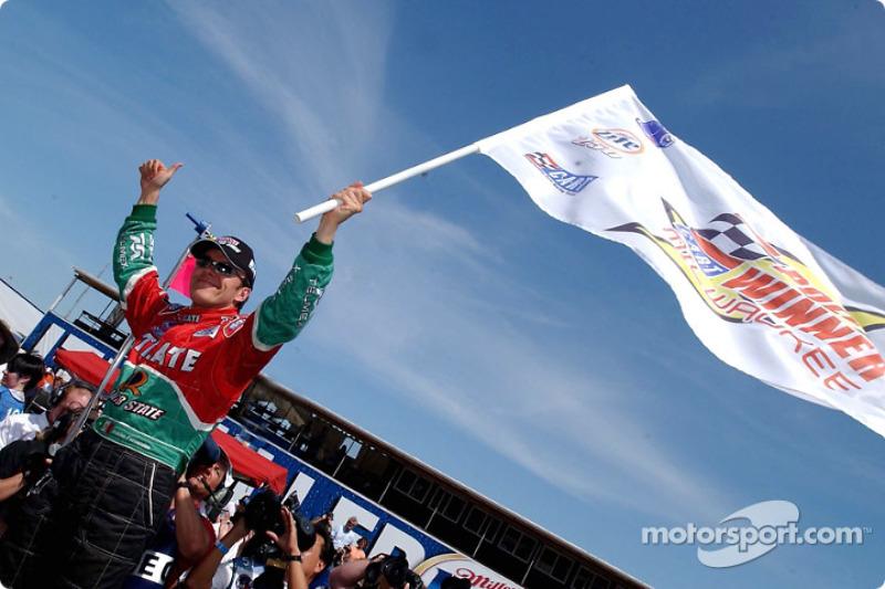 Adrian Fernandez celebrating pole position