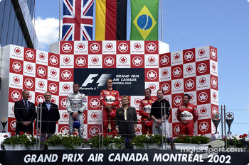 The podium: race winner Michael Schumacher with David Coulthard and Rubens Barrichello