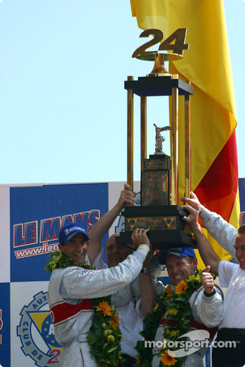 The overall and LMP 900 - LM GTP podium: race winners Emanuele Pirro, Tom Kristensen and Frank Biela celebrating