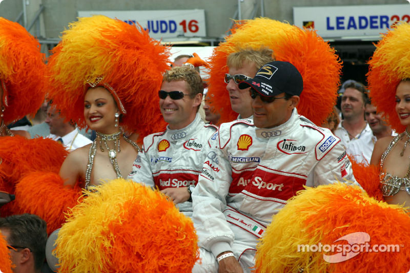 Tom Kristensen, Frank Biela and Emanuele Pirro with the Moulin Rouge girls