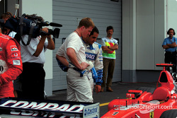 Ralf Schumacher and Juan Pablo Montoya checking the Ferrari
