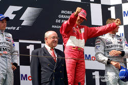 The podium: race winner Michael Schumacher with Kimi Raikkonen and David Coulthard