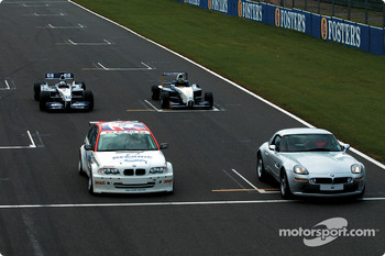Juan Pablo Montoya in the WilliamsF1 BMW FW24, Bruno Giacomelli in the BMW Z8, Tom Coronel in the BMW 320i Touring car and Jörg Müller in the Formula BMW