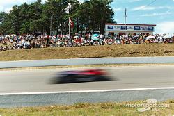 Fans line the course