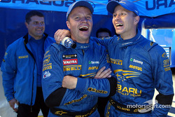 Tommi Makinen and Petter Solberg relaxing in the service area