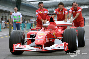 Ferrari crew members