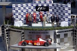 The podium: race winner Rubens Barrichello, Michael Schumacher and David Coulthard