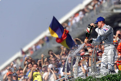 The podium: champagne for David Coulthard