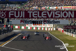 Michael Schumacher and Rubens Barrichello wait for green light