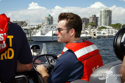 Defending NASCAR Winston Cup Champion Jeff Gordon pilots a '47 United States Coast Guard Cutter through Dinner Key Marina in Coconut Grove en route to an underwater scuba diving trip at Biscayne National Park