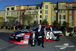 Champion Greg Biffle poses for photos prior to banquet ceremonies