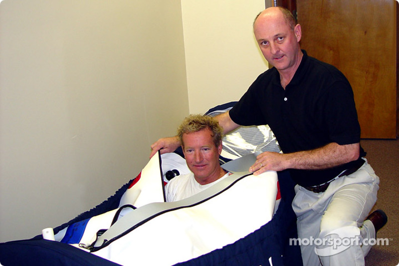 Hurley Haywood climbs in the Brumos Racing hyperbaric chamber