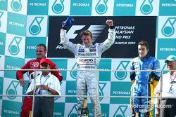 The podium: race winner Kimi Raikkonen with Rubens Barrichello and Fernando Alonso