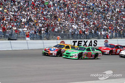 Bobby Labonte and Elliott Sadler lead the field to the green
