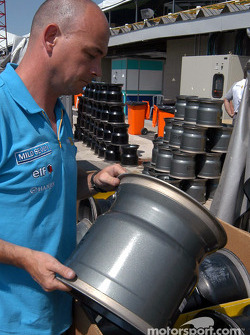 Renault F1 team member prepares the wheels