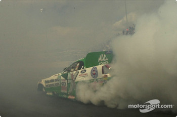 John Force lost in the smoke